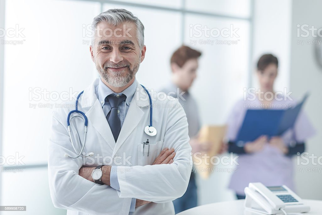 Confident doctor at the reception desk ストックフォト