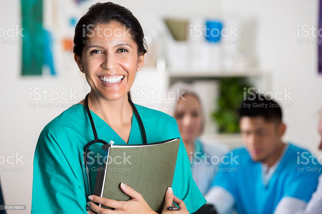 Confident doctor in medical staff meeting stock photo