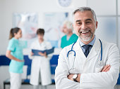istock Confident doctor posing at the hospital 938438758