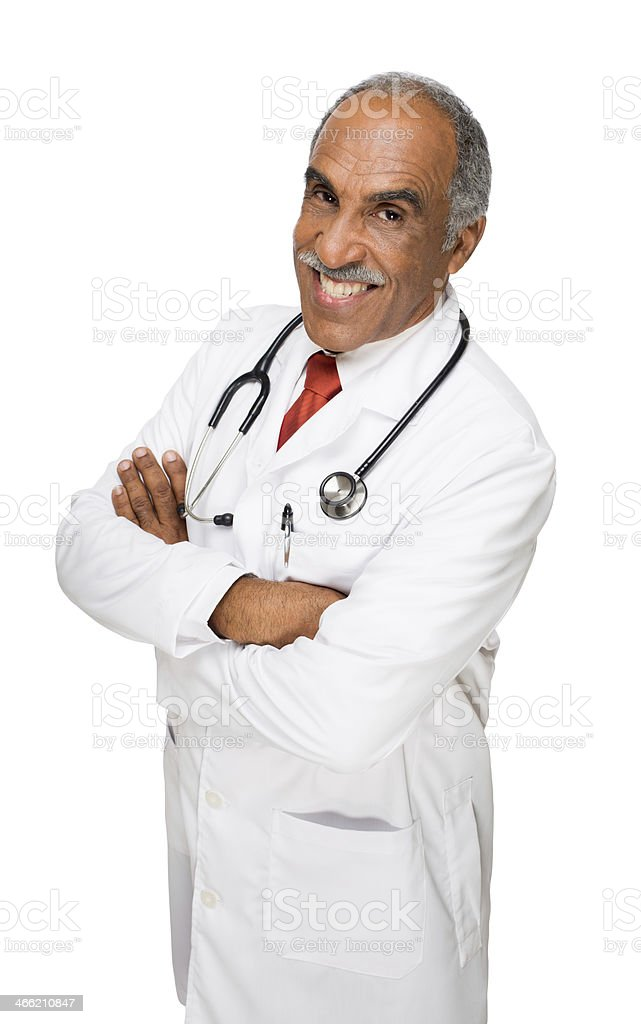 Confident doctor smiling with arms crossed royalty-free stock photo