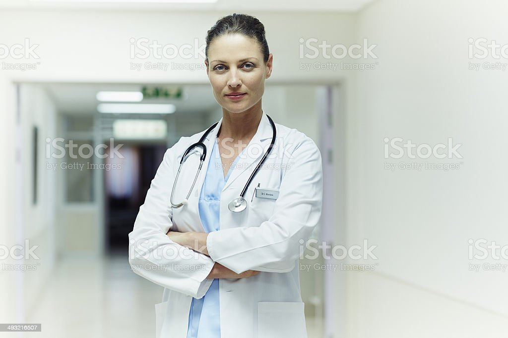 Confident doctor standing arms crossed stock photo