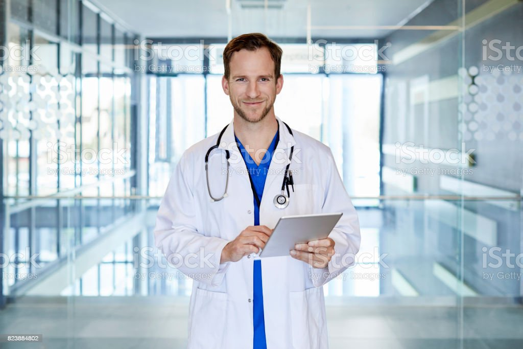 Confident doctor using digital tablet in hospital stock photo