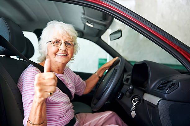 confident driving grandma - driver stock photos and pictures