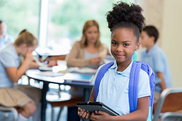 confident  elementary schoolgirl in classroom - private school stock photos and pictures