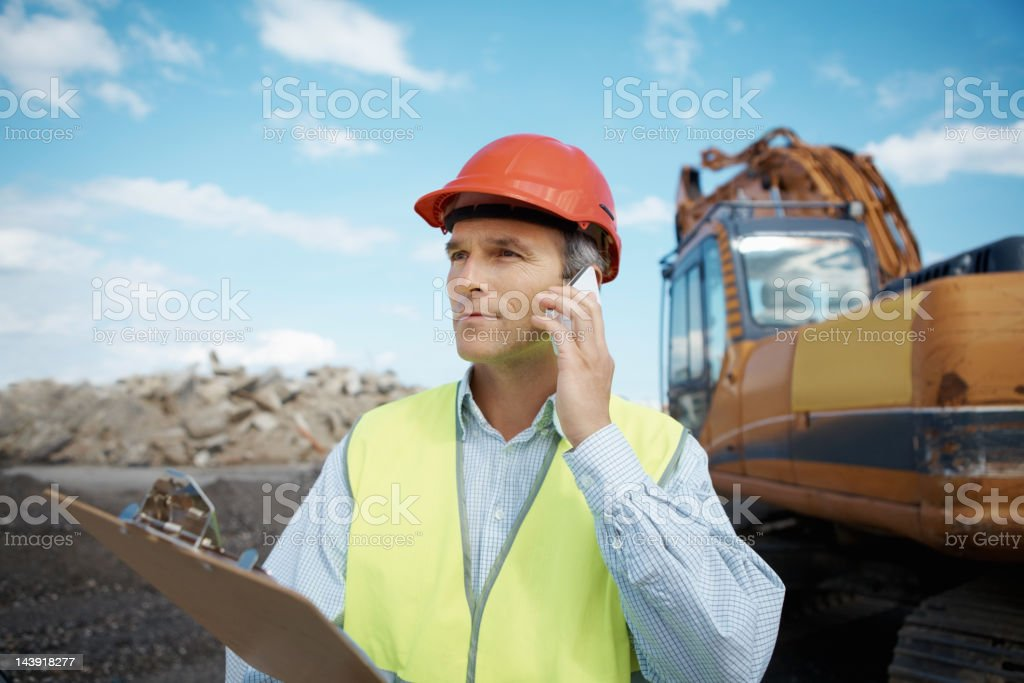 Confident engineer at work on construction site royalty-free stock photo