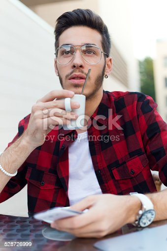 istock Confident entrepreneur drinking coffee focused in something. 528726999