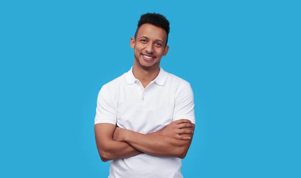 Confident ethnic man smiling for camera stock photo
