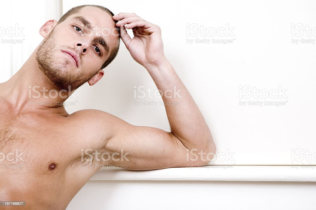Confident eye contact from a handsome shirtless male model stock photo