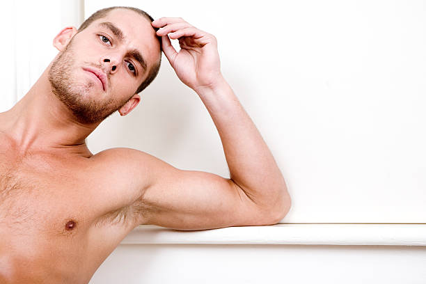confident eye contact from a handsome shirtless male model - young nudist boys stock photos and pictures
