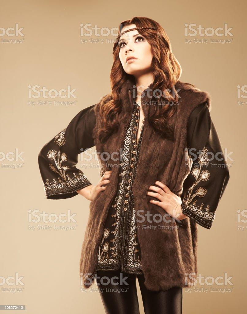 Confident fashion model standing with hands on her hips royalty-free stock photo