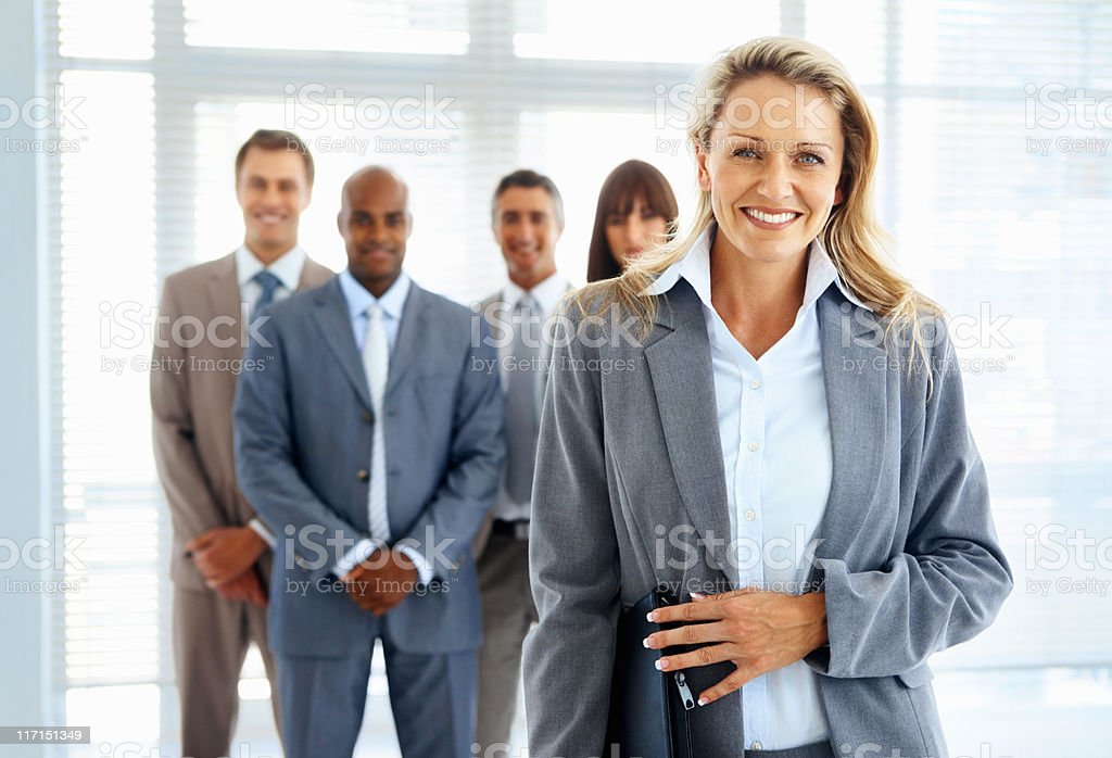 Confident female boss with business partners in office royalty-free stock photo