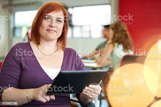 Confident female designer working on a digital tablet in red picture id523382738?b=1&k=6&m=523382738&s=612x612&h=lsarebb5m8vfuh4oeh5bxwdkceajgaq6f5psclhfr58=