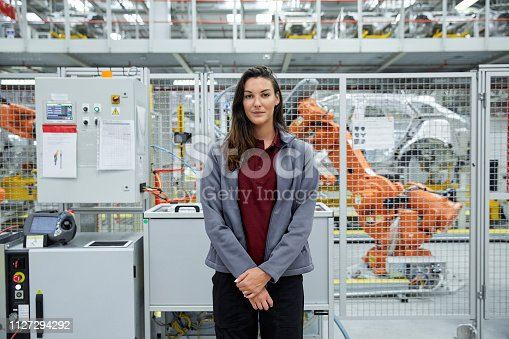 istock Confident female engineer in automobile industry 1127294292