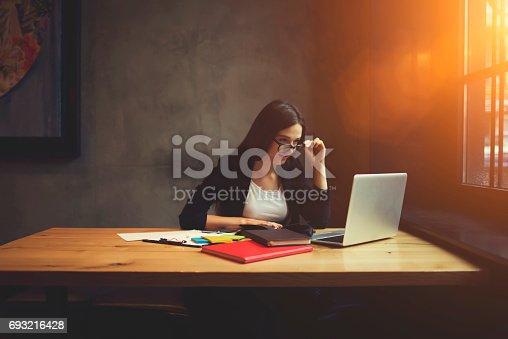 904263506 istock photo Confident female entrepreneur  checking email box 693216428