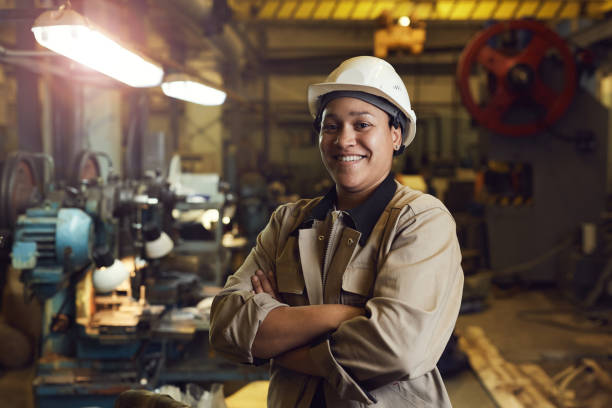 Confident Female Factory Worker stock photo