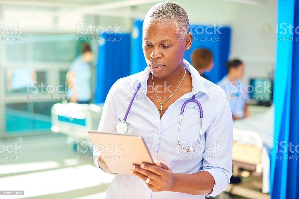 confident female hospital doctor stock photo
