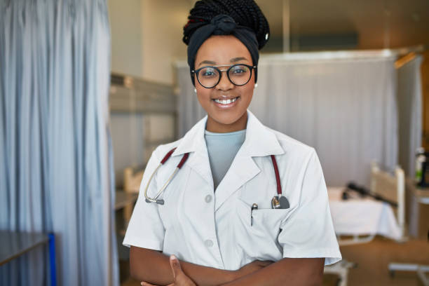 Confident female trainee standing in hospital stock photo