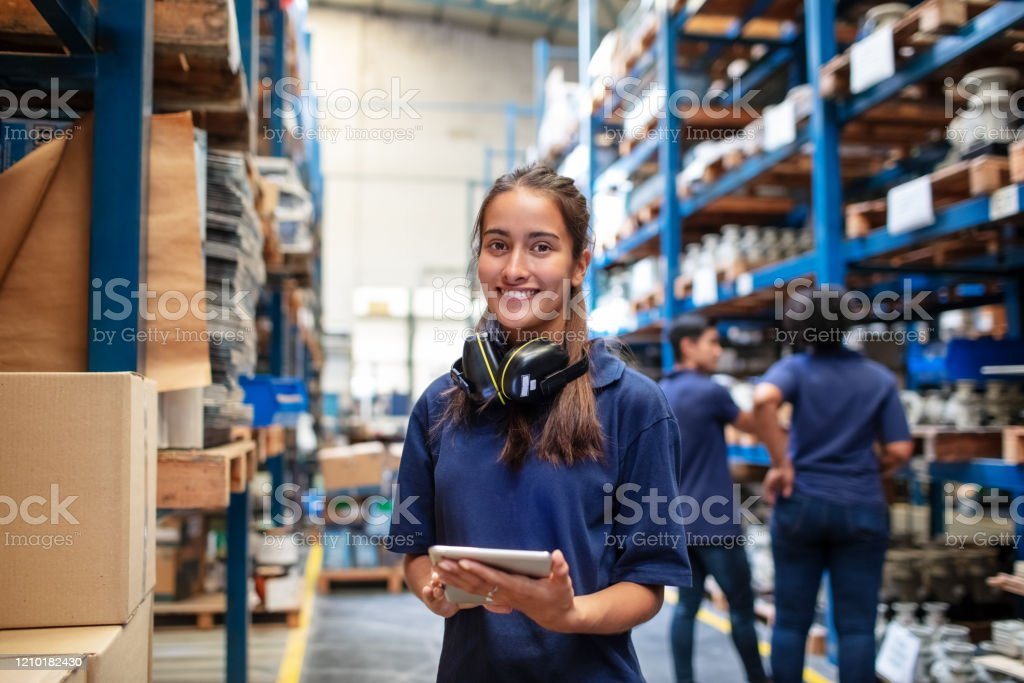 Confident female warehouse worker - Royalty-free Adult Stock Photo