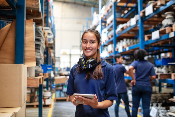 Confident female warehouse worker stock photo