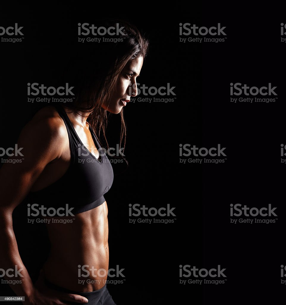 Confident fitness woman in sports clothing stock photo