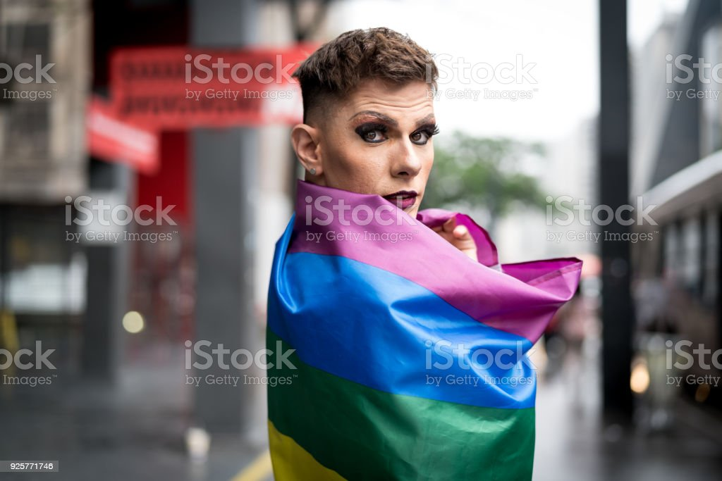 Confident Gay Boy Holding Rainbow Flag stock photo