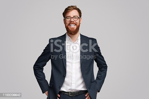 istock Confident ginger businessman smiling for camera 1153206642