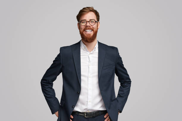 confident ginger businessman smiling for camera - ritratto uomo foto e immagini stock