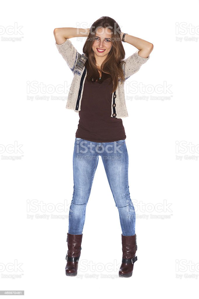 Confident girl holding hands behind head stock photo