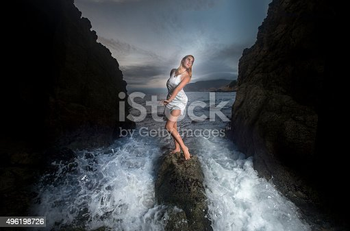 Confident girl Standing on the Rock