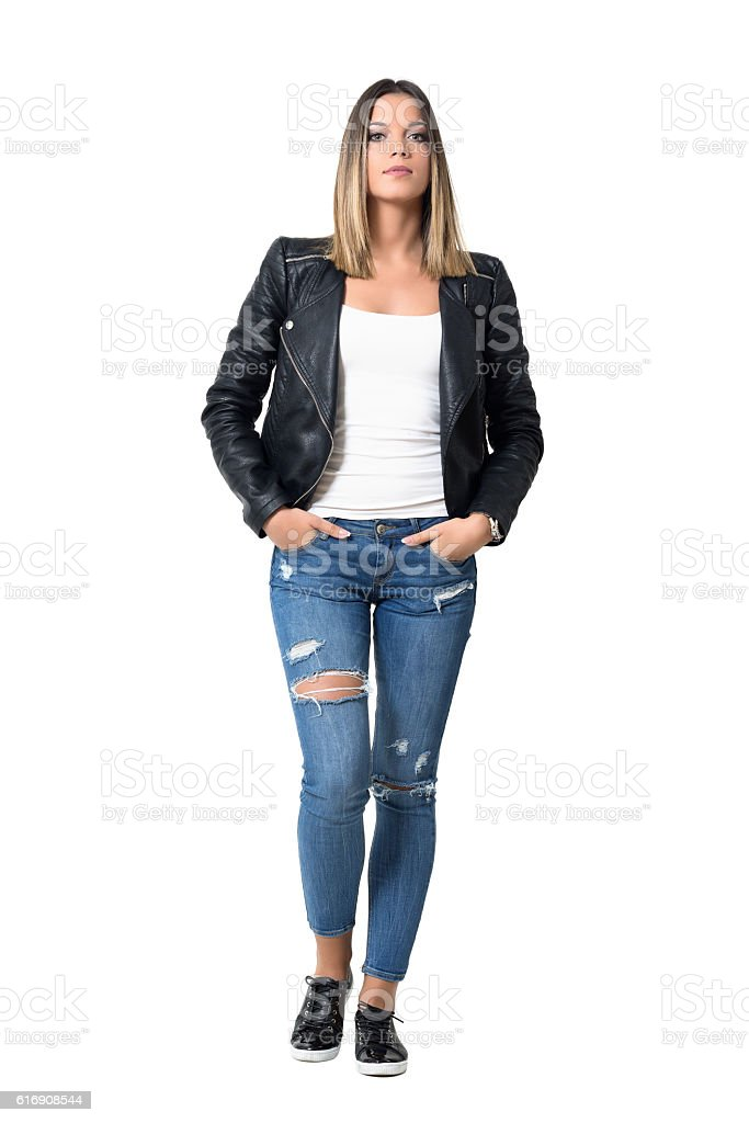Confident gorgeous beauty in casual clothes with hands in pocket stock photo