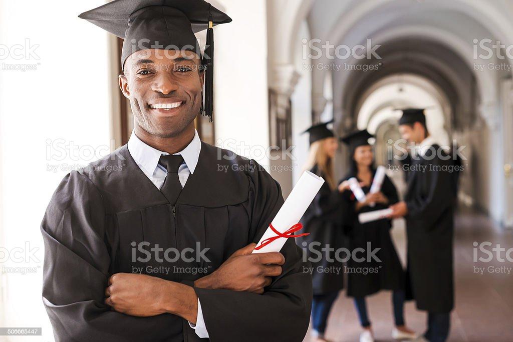Confident graduate. stock photo