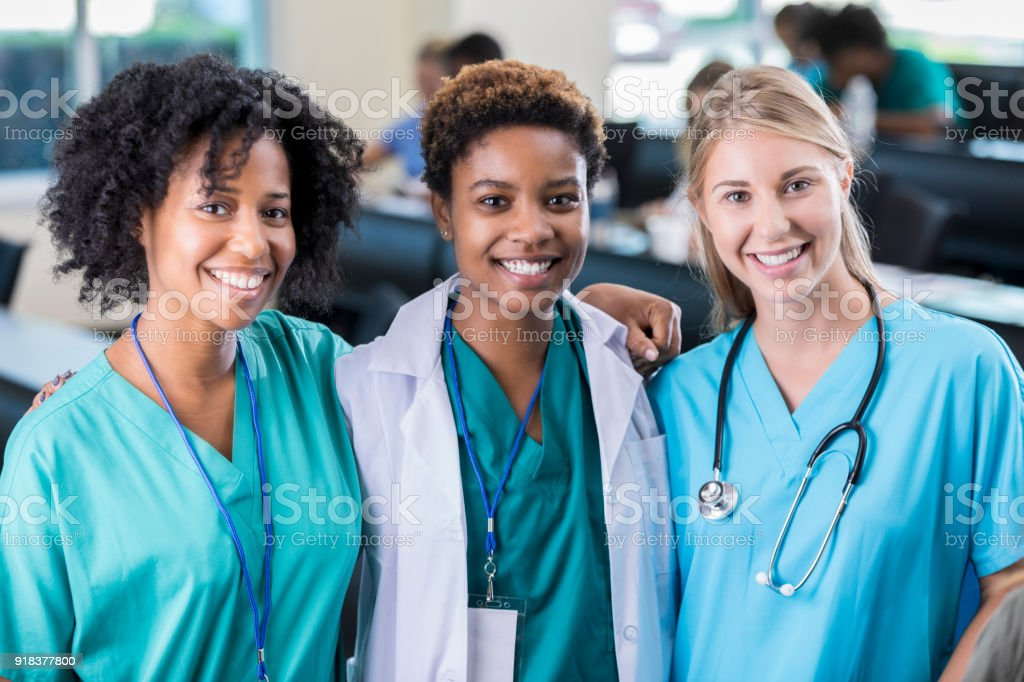 Confident group of diverse female healthcare professionals stock photo