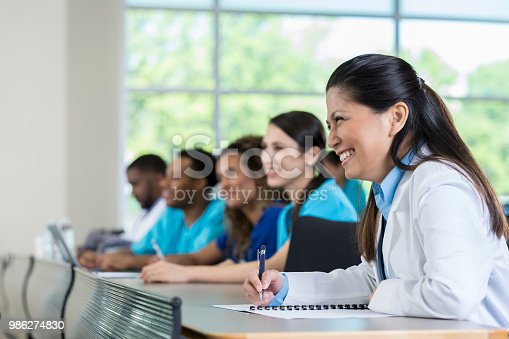 istock Confident group of healthcare professionals during healthcare conference 986274830