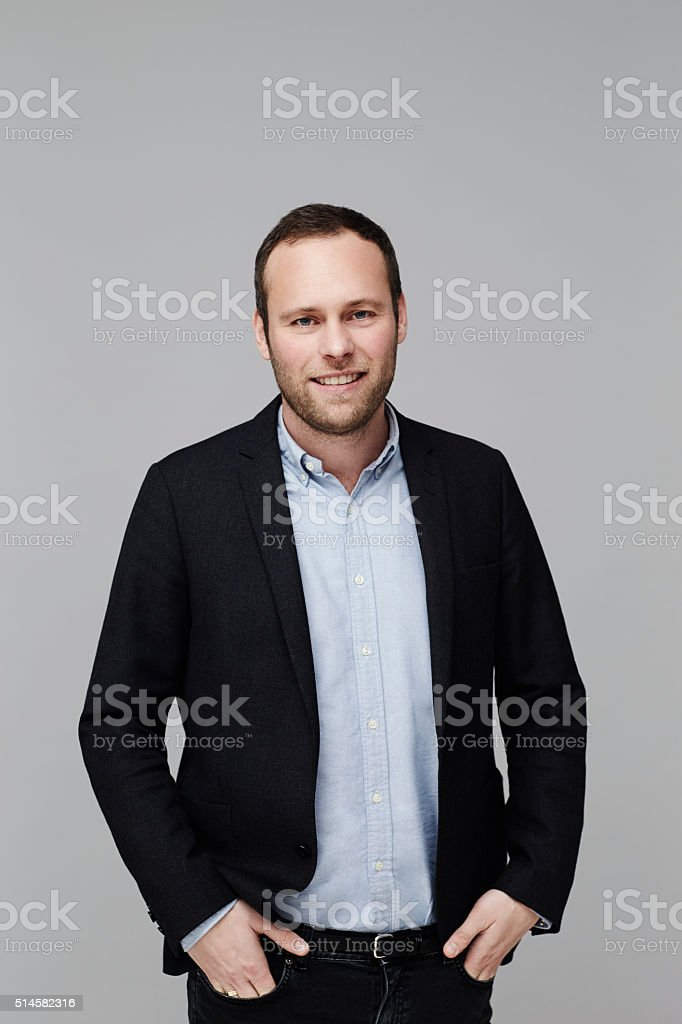 Confident guy in jacket, studio shot stock photo