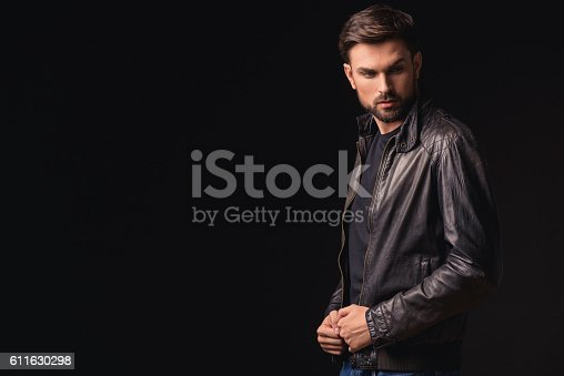 611630440 istock photo Confident guy thinking with seriousness 611630298