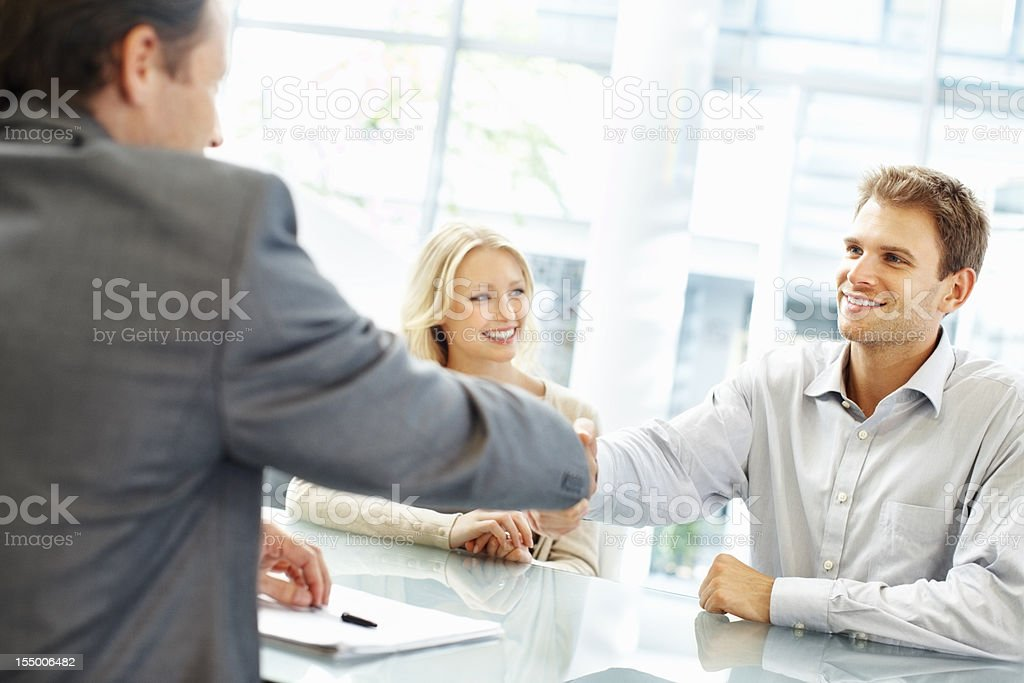 Confident hand shake between two executives royalty-free stock photo