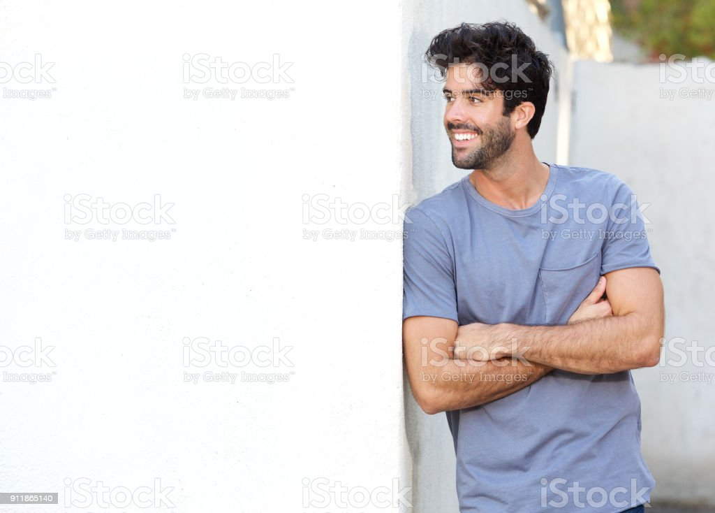 7fa2bf34c Confident handsome man standing with arms crossed outside - Stock image .
