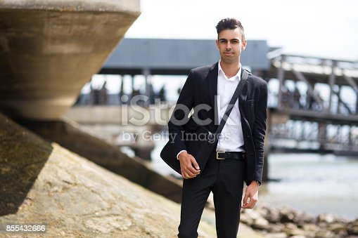 istock Confident handsome student walking after classes 855432666