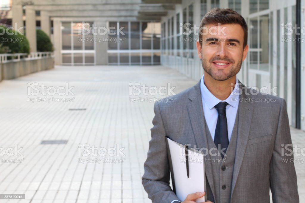 Confident handsome young businessman close up stock photo
