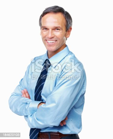 Portrait of handsome male executive smiling with arms crossed over white background
