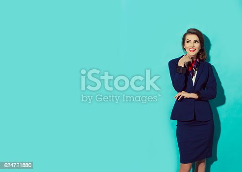 istock confident, happy business woman looking left and thinking 624721880