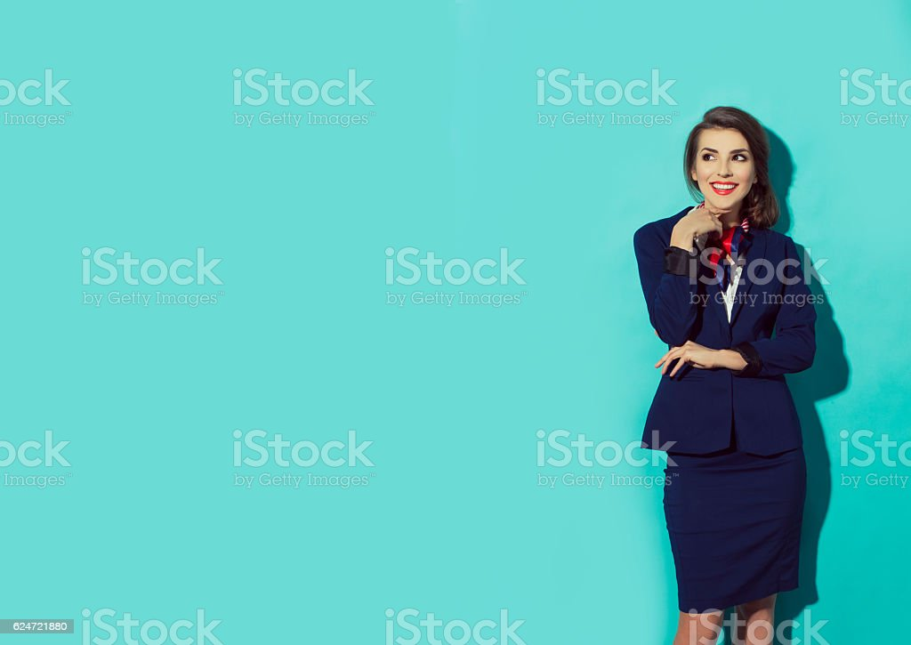 confident, happy business woman looking left and thinking stock photo