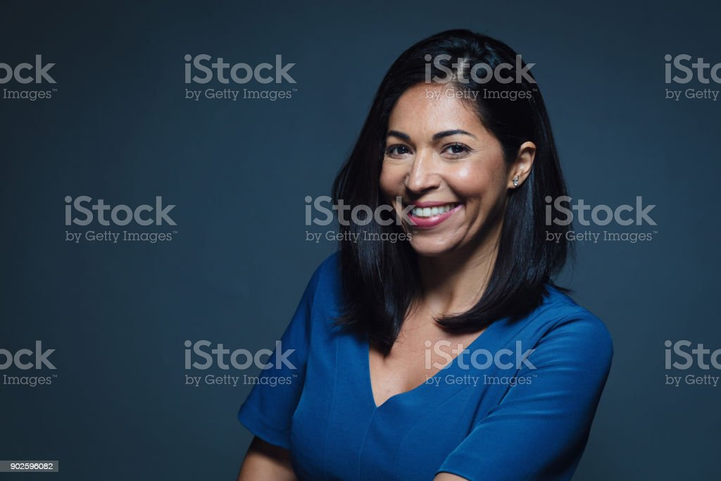 Confident happy smiling hispanic woman stock photo
