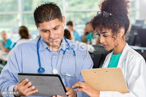istock Confident healthcare professionals discuss something 637181924