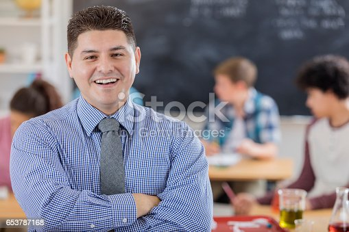 istock Confident high school chemistry teacher 653787168