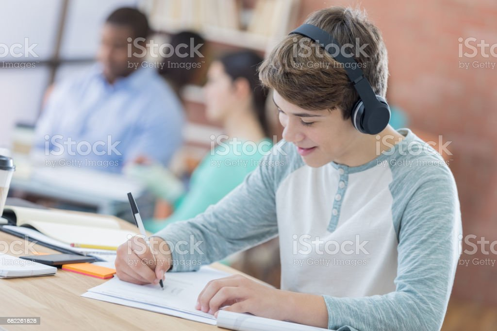 Confident high school student in class stock photo