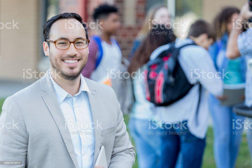 Confident high school teacher stock photo