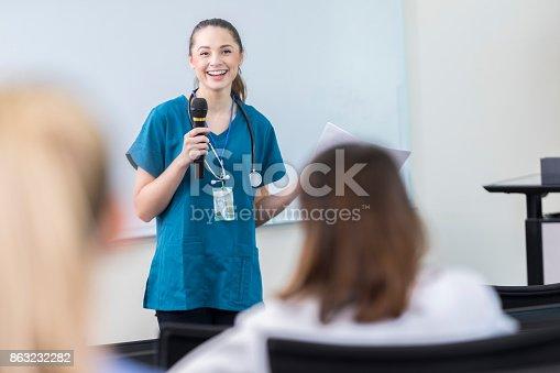 istock Confident Hispanic female doctor talks with medical professionals 863232282