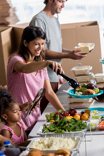 Confident Hispanic woman volunteering at soup kitchen stock photo