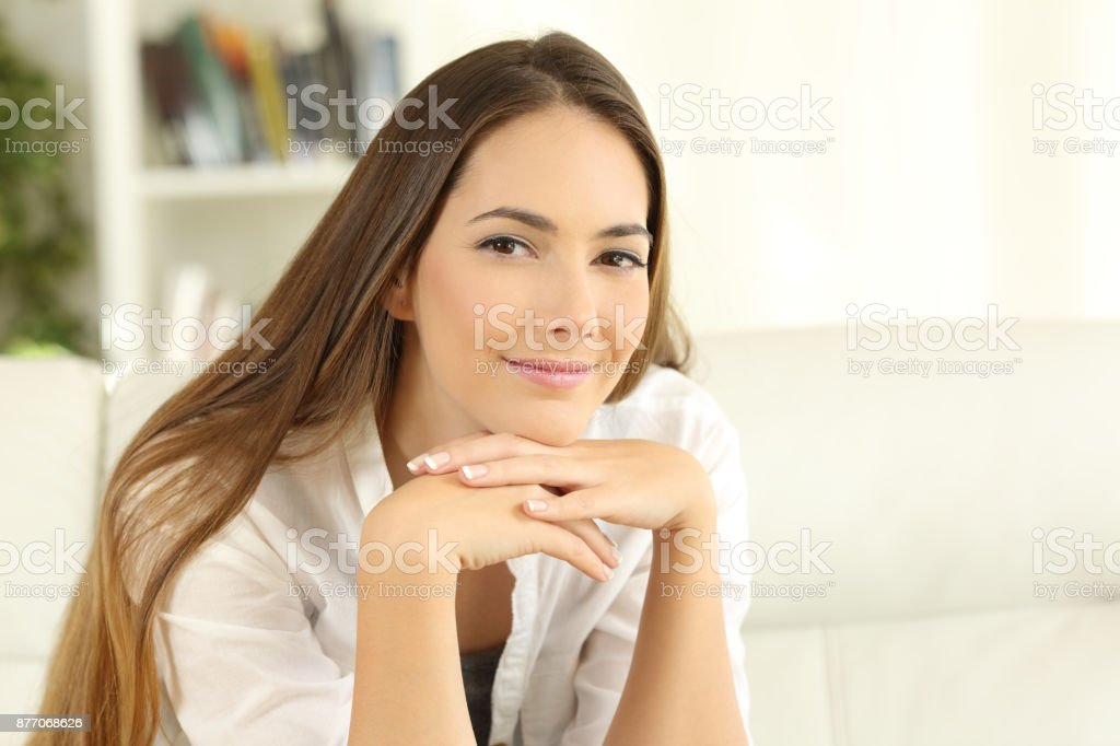 Confident home owner woman looking at camera stock photo